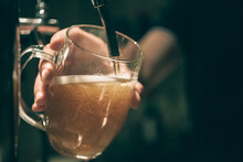 Barman Spilling A Draft Beer. ...