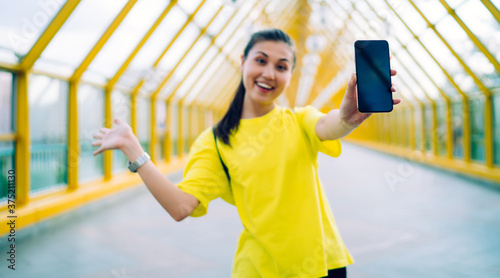 Happy cheerful asian hipster girl in activewear enjoying free time and mobile ap Fototapet