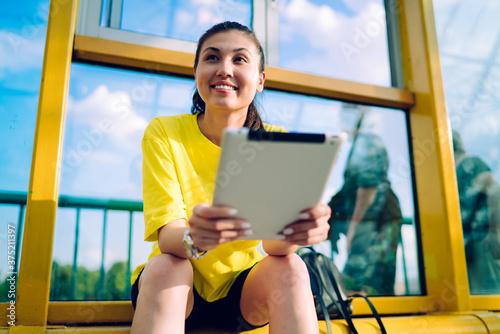 Vászonkép Smiling pretty asian female blogger enjoying share media in social networks via