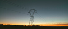Landscape With Electric Tower At Sunset.