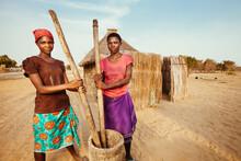 Young African Hambukushu Women Pounding Corn/millet