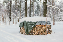 Pile Of Firewood In Snow