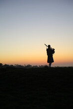 Silhouette Of A Bagpipe Player At Sunset