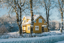 Yellow House In Winter Landscape