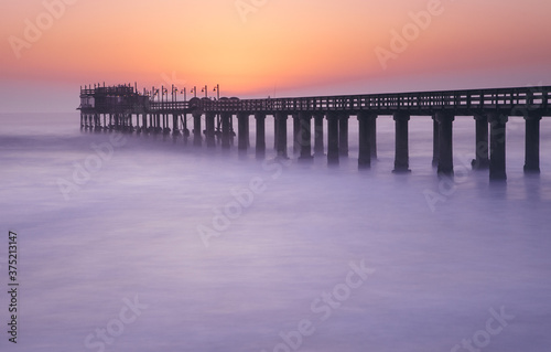Canvas Print Long exposure of Swakopmund pier at dusk, Namibia