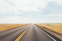 Empty Road In Dry Grassland
