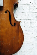 Old Weathered Cello Against A ...