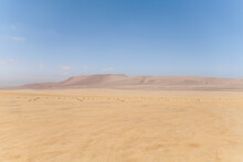 Arid Desert With Colourful Mou...