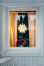 Christmas Star Ornament Hanging In Window