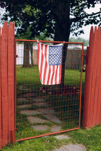 An American Flag Hangs An Old ...