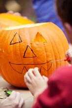 Pumpkins: Child Cutting Face F...