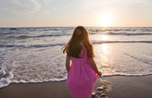 Girl In Pink Dress Standing At...