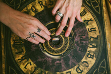 Group Of Friends Experimenting With A Ouija Board At Halloween