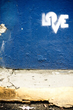 Graffiti Of The Word Love On A Bright Blue Wall