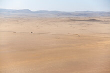 Two Cars Crossing A Desert Val...