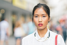 Asian Woman On The Street