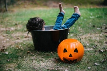 Toddler Lounges In Halloween Decorations