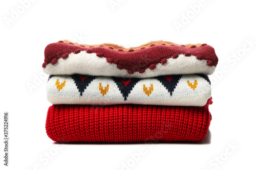 Pile of sweaters isolated on white background Fototapet