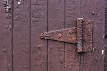 A Rusty Hinge On The Side Of A...