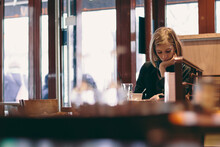Young Woman At A Cafe