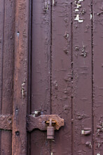 A Rusty Lock On The Side Of A ...
