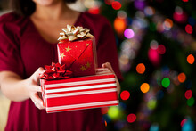 Christmas: Woman Holding Out S...