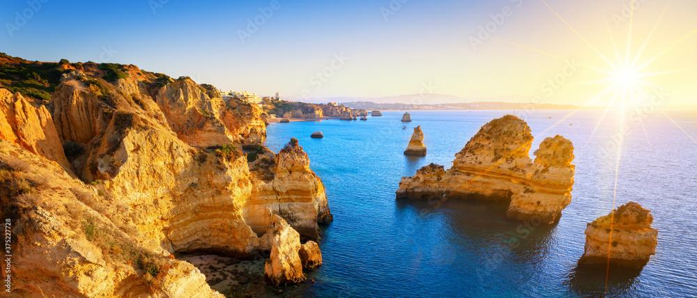 Fototapeta View seafront at sunrise, Algarve