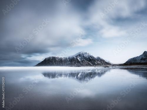 Skagsanden beach, Lofoten islands, Norway. Mountains, beach and clouds. Long exposure shot. Night time. Winter landscape near the ocean. Norway - travel