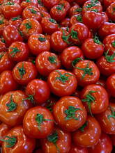 Fresh Tomatoes In The Market