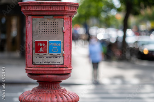 Photo Alarm - Emergency call box in urban setting NYC - Queens