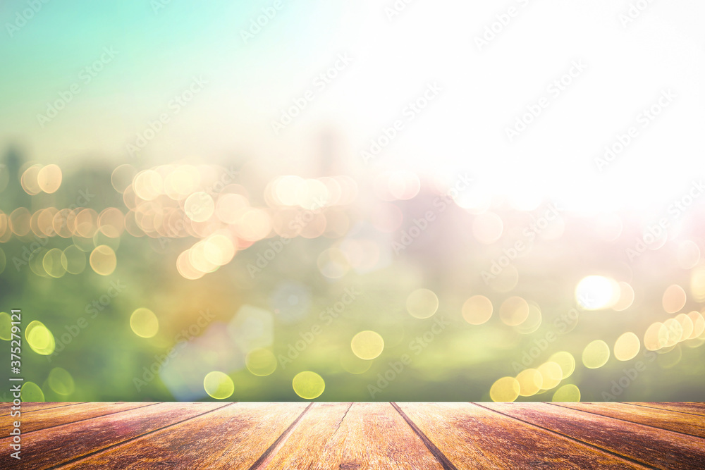 Fototapeta Blurred beautiful city view at twilight scene with wooden terrace background