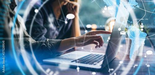 Obraz na plátne Female hands with laptop