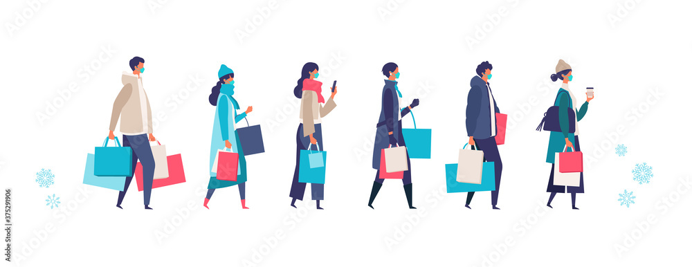 Fototapeta Masked people carrying shopping bags at winter. Man and woman taking part in seasonal sale at store, shop, mall on new normal lifestyle.