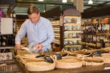 Man Choosing Bulk Products In ...