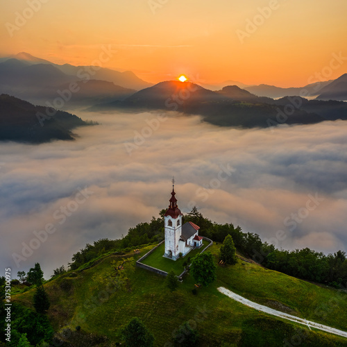 Photo Šebrelje, Slovenia - Aerial drone view of the beautiful hilltop church of St