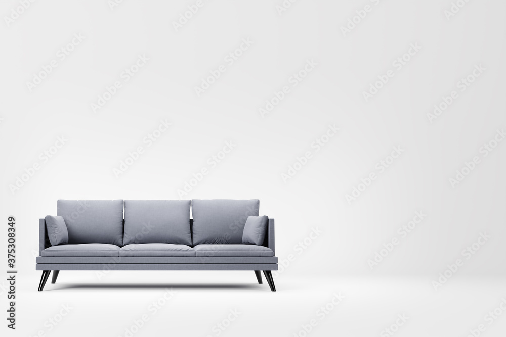 Fototapeta Grey couch with pillows on studio white background.