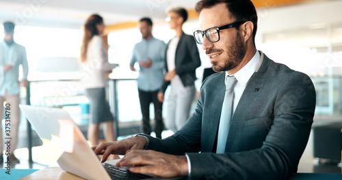 Businessman working on laptop in modern office