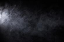 Cloud Of White Smoke On A Blac...