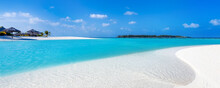 View Of A Tropical Beach On A Turquoise Water Lagoon In The Maldives With White Sand And Coconut Trees