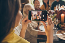 Photo Of Full Family Gathering Small Daughter Hold Telephone Shoot Portrait Season Traditional Event Friendship Dinner Big Table Turkey Generation In Home Evening Living Room Indoors