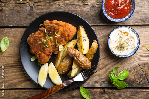 Homemade breaded German Weiner schnitzel with potatoes and lemon Canvas