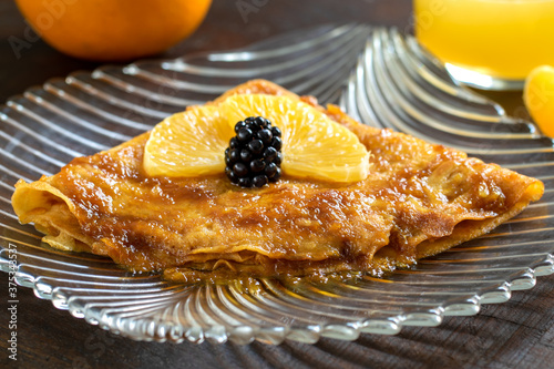 Delicious home made crepe suzette with caramelized orange sauce #375343537