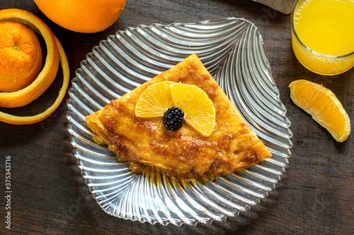 Top view of appetizing crepe suzette with caramelized orange dressing. #375343716