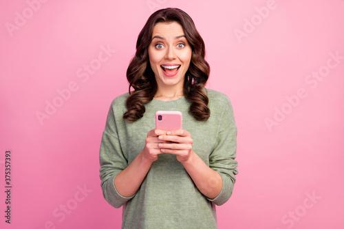 Vászonkép Portrait of astonished positive crazy girl use cellphone impressed by social net