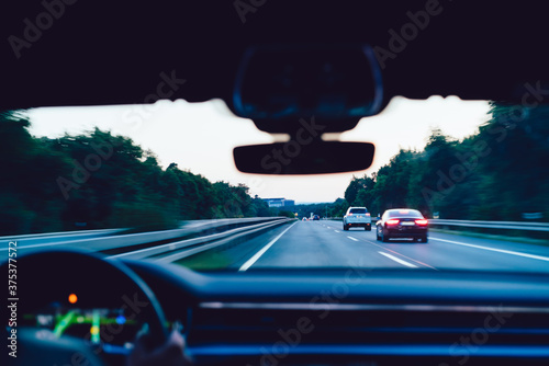 Fotografie, Obraz Selective window view oh interstate autobahn speedway, male driver steering auto
