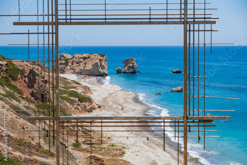 Photo Petra tou Romiou, Aphrodite's birthplace in Paphos, Cyprus behind a framed const