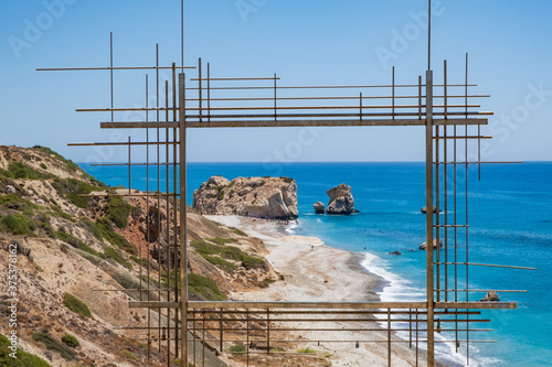 Petra tou Romiou, Aphrodite's birthplace in Paphos, Cyprus behind a framed const Wallpaper Mural