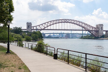 Astoria Queens Riverfront Trail At A Park Along The East River In New York City During Summer With The Hell Gate Bridge