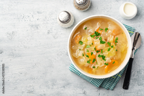 Homemade cabbage soup in bowl on concrete background Fototapet