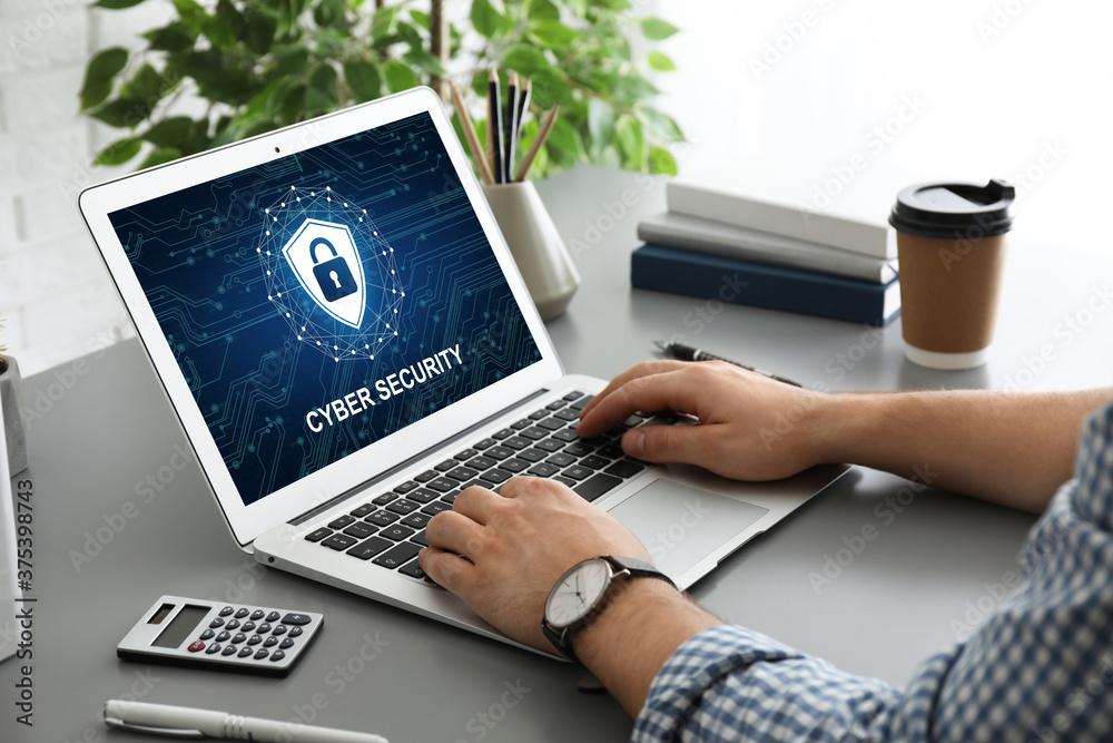Fototapeta Cyber security concept. Man using application on laptop, closeup